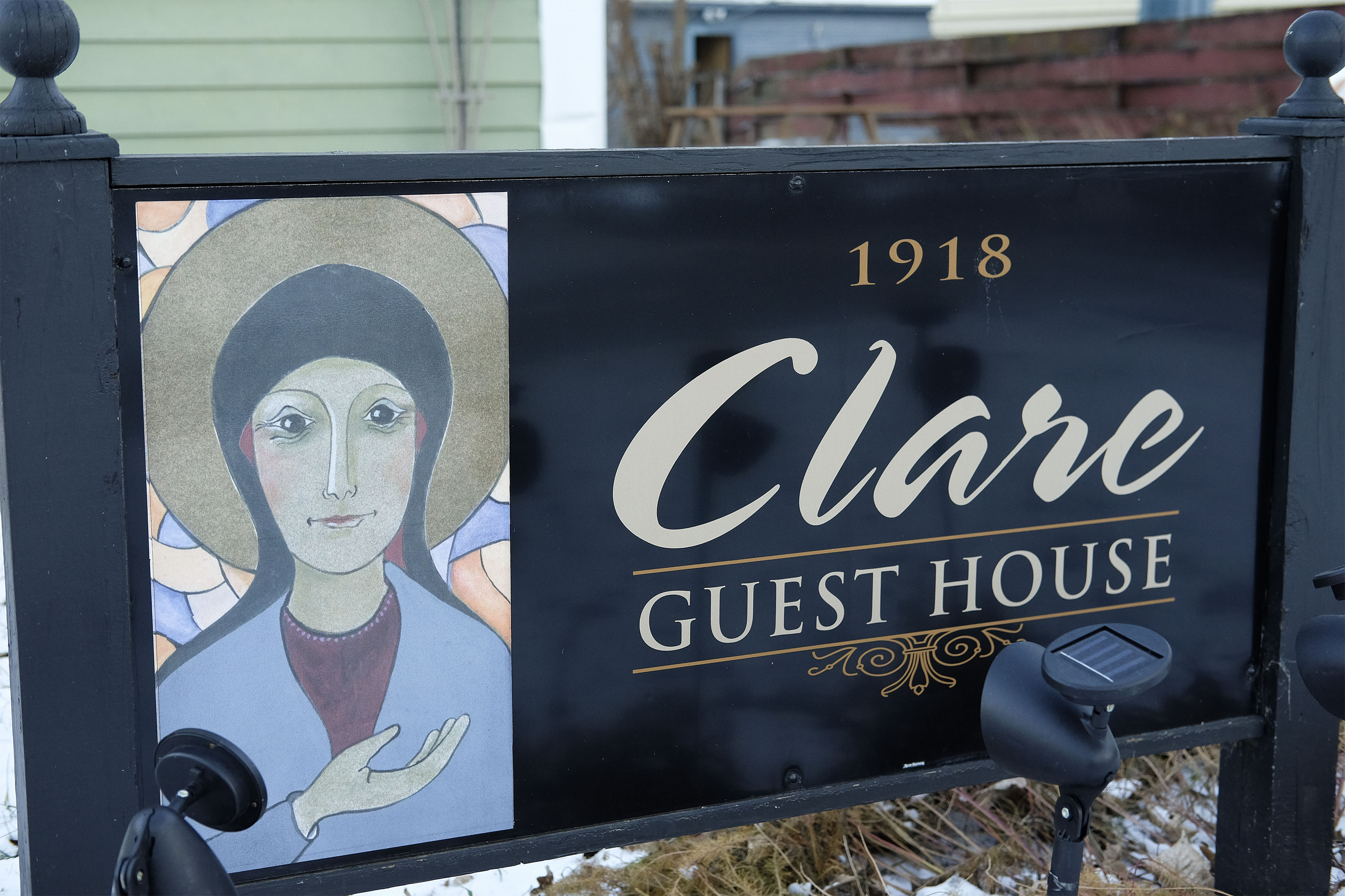 A Sign Announcing The Clare Guest House, A Transitional Home For Women After Serving Jail Time, Celebrates Its 10th Anniversary In Sioux City, Iowa Seen Monday, Dec. 12, 2016.  (photo By Jerry L Mennenga©)